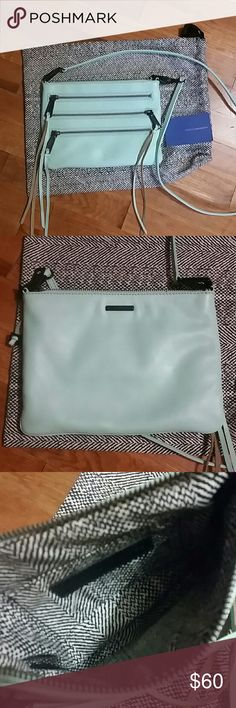 Mint 3-Zip Rocker Crossbody Authentic mint colored Crossbody with detachable strap.  Two functional zip pockets on front, zip close on top with slide pocket inside.  Comes with authentication card and dustbag.  No scuffs.  Very slight discoloration inside by zipper and outside by end of zipper.  Otherwise in perfect condition. Rebecca Minkoff Bags Crossbody Bags