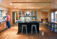 Oak, pine, and maple woodwork with a black granite island.