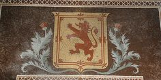 Love the way the thistle wraps around the crest. Replace the lion with a horse or put my clan crest