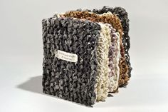"""Handmade book by Aimee Lee. Knitted hanji samples (2011). Varied knitted hanji with natural dyes, coatings, and techniques. 5 x 4.5 x 3"""" closed"""