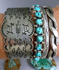 Layering of southwestern bracelets...