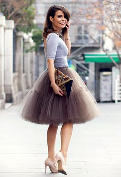 Smoky gray poofy skirt with light heather gray sweater, nude pumps, and beaded clutch.