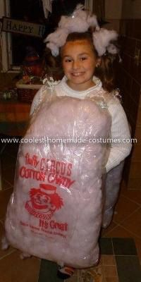 Homemade Cotton Candy Costume: This Homemade Cotton Candy Costume is 2 dry cleaning bags filled with dyed batting, 1/2 powder blue and 1/2  baby pink. I sprayed adhesive on the 2 bags