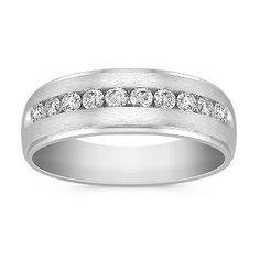 This sophisticated men's ring is crafted in quality 14 karat white gold with a sleek satin finish.  Ten round diamonds, at approximately .50 carat total weight, have been channel-set to add sparkle to the design.