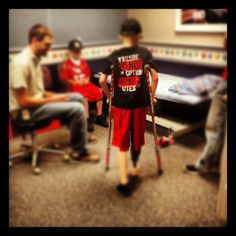 """Tristan taking his first steps on a prosthetic leg, wearing a shirt that says """"failure is not an option"""" very fitting I think for a childhood cancer warrior & amputee."""