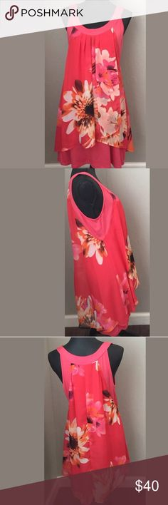 """Linea Domani large dress Coral floral knee length Such a cute dress. Above knee, loose fit over fitted. Polyester/Rayon/Spandex Bust 17 3/4"""" armpit to armpit. Waist 17"""" side seam to side seam. Hips 19 1/2"""" side seam to side seam. Length 33 1/2"""" shoulder to hem. Measurements are approximate. Measured inner lining, it stretches too. Linea Domani Dresses Midi"""
