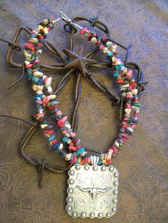Great necklace to go with just about anything! Multi-colored beaded necklace with longhorn steer concho pendant. $45