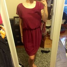 Adorable flowy maroon dress Adorable flowy maroon dress, scrunches up around middle area. Has a liner underneath. Could be worn with a belt. 10/10 condition City Triangles Dresses