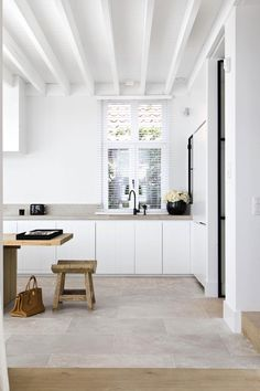 concrete counters + white slab cabinets