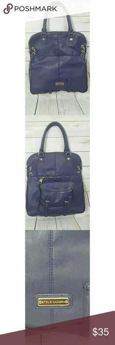 Large Navy Blue Steve Madden Handbag Steve Madden EUC - Navy Blue purse with gold details. - No shoulder strap provided.13 in length - 4.5 in width - 15 in height Steve Madden Bags