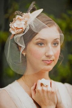Hat fascinator with blush silk blossoms, guinea feathers and blusher veil: