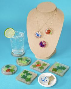 Resin coated coasters and necklace pendants. How cute would the pendant be with our kids picture in it!