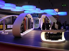"""The inspiration came from observing the harp as a sensual and magical music instrument, so large harps in Corian from 6 to 10 metres long and 3 metres high, were designed to accommodate items of the Runtal collections on rotating black panels. The composition of harps has been made simpler thanks to the use of light ashlars with sophisticated concealed steel closures."""", says Giancarlo Zema Design Group on Harps."""