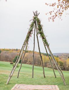Rustic teepee backdrop with a vintage rug