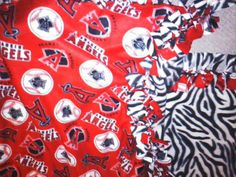 Now with reduced shipping...  Anaheim Angels & Zebra Blanket by StandoutGifts on Etsy, $45.00