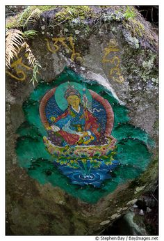 Painting of Guru Rinpoche on boulder, Paro Valley, Bhutan //