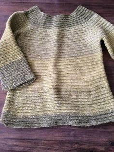 Needlebound / nalbound sweater made with 400 grams of three-ply wool yarn bought in Norway and using unknown stitch. Made with loose binding that started from the bottom and then some decreases before leaving holes for the sleeves that were made last, by Johanna Janzén. Posted [in Swedish] 2015-03-01 in Nålbindning group @ FaceBook. Please see link for thread!