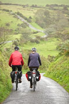Couple cycling on Devon lane http://www.the-carter-company.com/where/devon-and-cornwall/cycling-holidays/