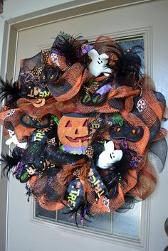 Whimsical Halloween mesh wreath. The spooky eyes and hands light up!