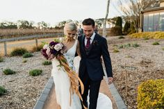 FLOWERMUSE lovers Amy and Harry captured by Dan Cartwright Photography at Centennial Vineyards #southernhighlandswedding #sydneyflorist #melbournewedding #melbourneflorist #brides #weddingflowers #bouquet #weddinginspo