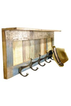 Wooden scrap shelf made with reclaimed wood & five metal hooks