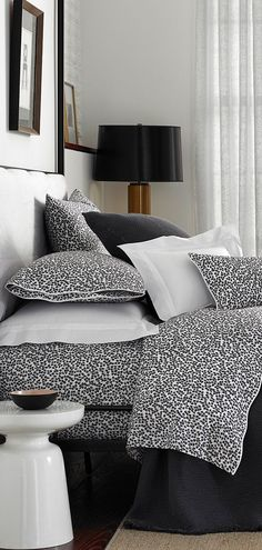 This sophisticated print is a true Matouk original, inspired by a textile found deep in their treasured archives.  Margot's small, simply drawn leaves fit snugly together on their Luca percale, for a pattern that nearly reads as a solid color.   #matouk #designerbedding #luxurybedding #bedroomideas #bedding