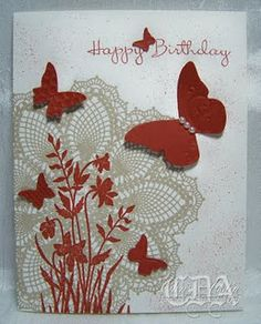Doily with Butterfly embosslit. It's almost the Kraft, Red and Ivory combo I love so much.