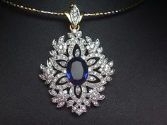 Exquisite pendant crafted well in with and stone to enhance it's look Gems Jewelry, Crystal Jewelry, Bridal Jewelry, Jewelry Sets, Gemstone Jewelry, Diamond Earrings Indian, Diamond Brooch, Stackable Wedding Bands, Pearl Necklace Designs