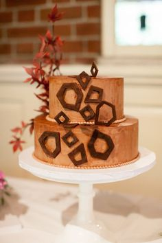 For a couple who originally didn't really want cake at their wedding, we married his love of geometry and her love of Japanese art.  Sweet regards from Sugar Flower Cake Shop!