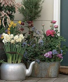 Flea market finds come to life as containers for pots of flowers