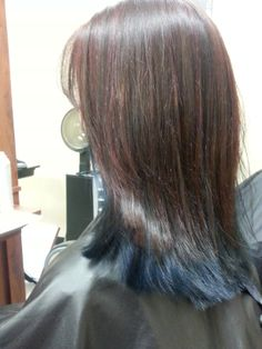 Chocolate hair color with red highlights and blue underneath. Looks a lot like mine.