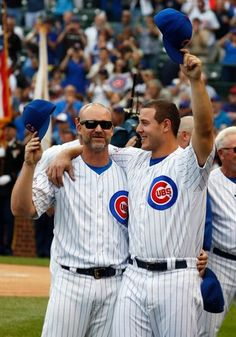 Chicago Cubs' Anthony Rizzo, right, and David Ross celebrate their division title before a baseball game against the Milwaukee Brewers Friday, Sept. 16, 2016, in Chicago