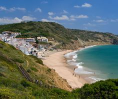 Salema, Portugal    Located three hours south of Lisbon near Cape Sagres, Salema is a small fishing village known for its gentle Atlantic shore break on a wide beach between two steep cliffs.