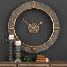 "This is one beautiful clock at 39"" in diameter with real fir wood and  antiqued gold accents. The center piece is a floating dial which makes it easy to change the battery. Clever!! Designed by John Kowalski"