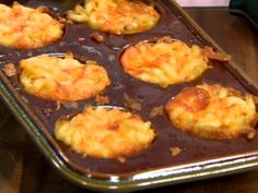 Mini Macaroni Pies from FoodNetwork.com   I'm giving this one a try for Turkey day, I'll let you know how it turns out.