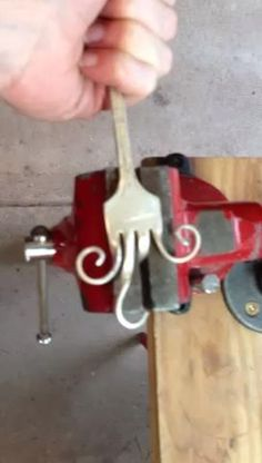 Twist like this. Good detail on how to make a hook from old silverware.