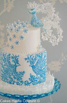 The Blue Bird Cake, a unique take on a peacock wedding cake, white & blue, beautiful!
