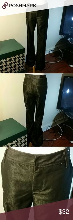 Calvin Klein Jean trousers Shimmery black Calvin's, fits like a trouser and is boot cut. Only worn once. Calvin Klein Jeans Boot Cut