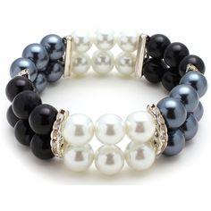 Let this versatile stretch bracelet adorn your look for a dressy night out on the town or out and about. The bracelet features black, white and grey glass pearl beads and crystal rhinestones filaments.