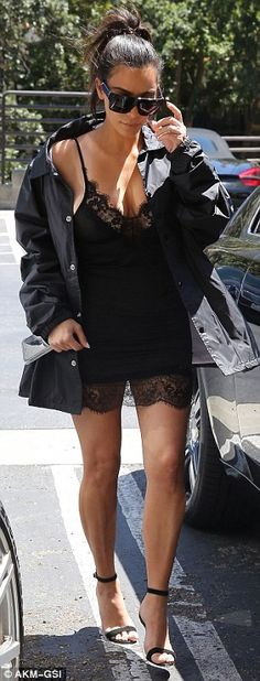 Busty Kim Kardashian dons lacy lingerie mini dress for lunch along with oversized Pablo jacket | Daily Mail Online
