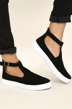 """Amp up your street chic style with the Anna Black Nubuck T-Strap Sneakers! These dreamy vegan nubuck leather sneakers have a T-strap upper, with adjustable antiqued gold buckle ankle strap. 1"""" white bumper sole."""