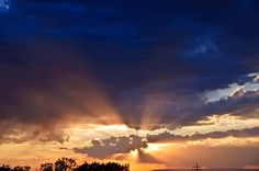 Sunbeams Over Grand Mesa by Eric Rundle