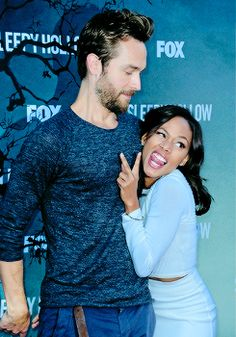 butdrowning:  I want to talk about this picture for a sec. First, Nicole Beharie and Tom Mison are the greatest, full stop. Second, what I love most about it (aside from their stupid fucking faces) is that I would buy this as a picture of a modern-dressed Ichabod and Abby totally as bros, taking a hot second away from the stress of being all chosen and shit to bro around and, idk, go play some cornhole. On the other hand, I would also totally buy this as a picture taken when someone…