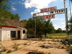 """The Last Motel / First Motel in Texas, in Glenrio, an old ghost town on Route 66 on the Texas - New Mexico border.    A Glenrio fun fact: The town's name is formed from the English """"glen"""" for valley, and the Spanish """"rio"""" for river, eventhough the town doesn't sit in a valley or near a river. The town was founded in 1903, after a railroad line was established in the vacinity. In 1938, a film crew spent about 3 weeks filming portions of the film """"The Grapes of Wrath."""""""