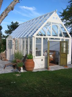 y designed greenhouse with vintage doors, brick floors, and stone for the out side. Mini Greenhouse, Greenhouse Wedding, Greenhouse Plans, Greenhouse Gardening, Gardening Tips, Garden Buildings, Garden Structures, Orangery Conservatory, Backyard Sheds