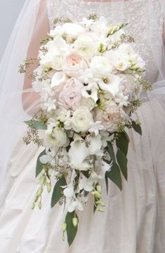 Many bride-to-bes might know the wedding flower they want in their own bouquet, however are a little mystified about the rest of the wedding flowers required to complete the ceremony and reception. Cascading Wedding Bouquets, Cascade Bouquet, Bride Bouquets, Bridal Flowers, Flower Bouquet Wedding, Floral Wedding, Flower Bouquets, Purple Bouquets, Trailing Bouquet