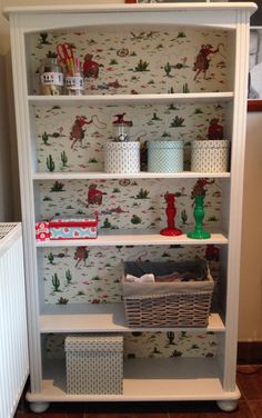 Upcycled pine shelves, painted and back board in Cath Kidston Cowboy wallpaper
