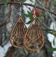 laser-cut wood earrings - these earrings would make a great costume / cosplay accessory piece!
