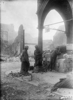 WWI, 17 March 1917, Bapaume. Men of the Australian 2nd Div outside the Mairie. The town was occupied by the Australians that day, following the German withdrawal to the Siegfried Stellung (Hindenburg Line). ©IWM E(AUS) 393