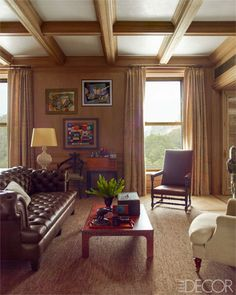 Steven Gambrel ~ Library - The custom-made chesterfield in the library is upholstered in a Dune leather, and the circa-1950 lacquer cocktail table is by William Haines; the 1950s paintings were found by the designer, the walls are paneled in oak, the curtains are of a Jasper fabric, and the rug is by Beauvais Carpets.